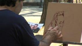 Street artist in the square in the center of Varna, Bulgaria stock video