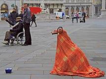 Street artist in the strange costume is entertaining passers Stock Photos