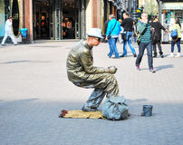 Street artist on the street in Dresden depicts a frozen statue.  Germany Royalty Free Stock Image