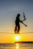 Street artist: the tightrope walker Stock Image