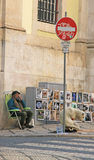 The street artist will sell their own work on street Lisbon (Portugal). Stock Images
