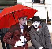 Street artists as Charlot. Street artists performing a famous Charlie Chaplin character on the street of Venice royalty free stock photo