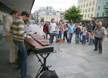 Street artists in Bergen. Street artists performing in the city centre, Bergen, Norway. Every few steps you can watch them play, perform, entertain Stock Image