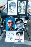 Street artists on Leicester square, popular place with cinemas, cafes and restaurants. London. UK. LONDON, UK - JUNE 7, 2015: Street artists at the evening time Stock Images