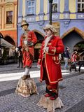 Street Artists, Prague Old Town, Czech Republic. Street artists in old red costumes on the Old Town Square - Staromestska namesti. Prague Old City Royalty Free Stock Photo