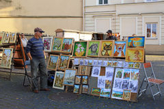 Street artists sell paintings to the tourists on the street mark Royalty Free Stock Images