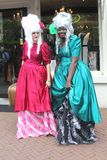 Street artists in medieval costumes at yearly Street Festival in Leeuwarden,Friesland,Netherlands. Street artists in elegant dresses are doing an act at the Stock Photography
