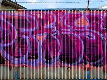 Graffiti. Street arts art in prague, sprayed works of street artists, painting on corrugated sheet metal royalty free stock images
