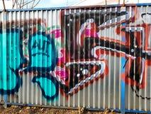 Graffiti. Street arts art in prague, sprayed works of street artists, painting on corrugated sheet metal royalty free stock photography