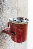Red ashtray on a wall full with cigarette old retro style not cleaned Stock Photos
