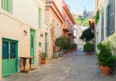 Street of Athens, Greece. Small paved street of Placa district with Acropolis hill in old town of Athens, Greece Stock Images
