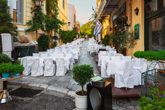 Street of Athens old town with decorated white wedding tables. Royalty Free Stock Photo