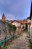 Street in Avigliana. Village known from 13 century in rainy spring day Royalty Free Stock Photography