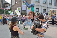Street-Band Performing at the festival of Ghent. GHENT, BELGIUM, 25 JULY 2014: Unidentified Street-Band and Acrobats Performing at the festival of Ghent Stock Photography