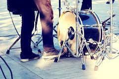 Street musicians, kick drum and drummer legs in action. Street band playing rock music, kick drum and drummer legs in action, close up stock photo