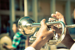 Street band playing, selective focus on the hands Royalty Free Stock Photography