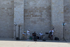 Street band in Saintes-Maries-de-la-Mer, France Stock Photography