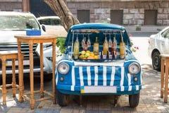Street bar inside the old vintage car. Royalty Free Stock Photos