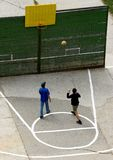 Street basketball. Boys playing basketball on the street royalty free stock photo