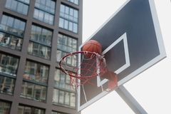 Street basketball court. And basketball Hoop on sunset background Royalty Free Stock Photography