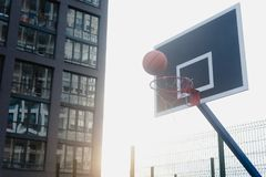 Street basketball court. And basketball Hoop on sunset background Royalty Free Stock Photos
