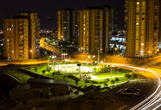 Street Basketball Field. A night view from a street basketball pitch stuck between the buildings Royalty Free Stock Photography