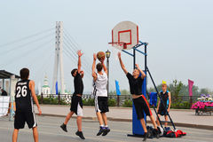 Street basketball at the foot bridge (The bridge of lovers) in T Royalty Free Stock Photos