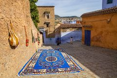 Street with beautiful big carpet, Chefchaouen, Morocco Stock Photography