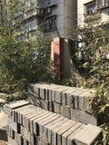 Street in Beijing. Old apartment building vs modern sky scraper on one of the Beijing Stock Photo