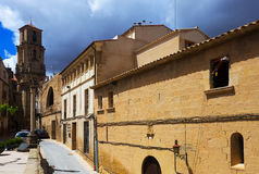 Street and bell tower of church of the Assumption. Calaceite Stock Photo