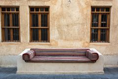 Street bench covered with ornate seat cushion in Doha. Qatar royalty free stock photos
