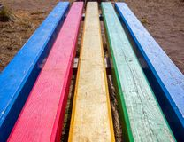 Street bench from multi-colored boards stock images