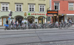 Street bicycle parking and pharmacy in Graz, Austria. Stock Photography