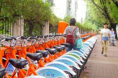 Bicycle rental facilities in the streets of the city. Street bike rental facilities, convenient for people to use public bicycles. In Shenzhen, china Royalty Free Stock Photos