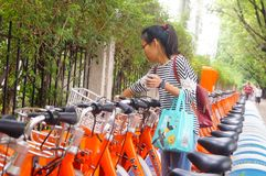 Bicycle rental facilities in the streets of the city. Street bike rental facilities, convenient for people to use public bicycles. In Shenzhen, china Royalty Free Stock Photo