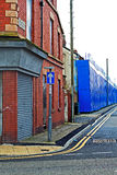 A street of boarded up derelict houses awaiting regeneration in Stock Images
