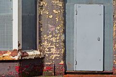A street of boarded up derelict houses Stock Image