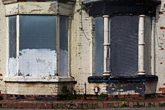 A street of boarded up derelict houses Royalty Free Stock Photo