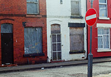 A street of boarded up derelict houses Stock Photos