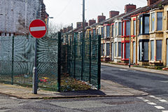A street of boarded up derelict houses Royalty Free Stock Image