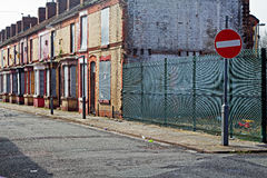 A street of boarded up derelict houses Stock Images