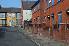A street of boarded up derelict houses Stock Photography