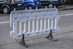 Street bollards to prevent intrusion into the road. Stock Photo