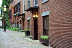 Street on Boston's Beacon Hill. Beacon Hill is a fascinating, early 19th century neighborhood with narrow streets. The row houses are nearly all in brick in Royalty Free Stock Images
