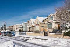 Street of brand new luxury houses on blue sky background in winter royalty free stock images