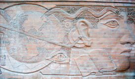Street Brick Carving on the Wall. Royalty Free Stock Photos