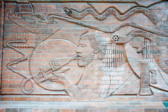 Street Brick Carving on the Wall. Royalty Free Stock Photo