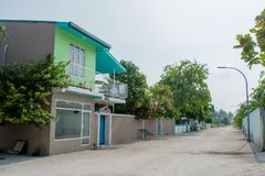 Street with buildings and houses at the Maamigili island. In Maldives Royalty Free Stock Image