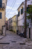 Street and buildings in Paxoi island, Greece. On an overcast day Stock Image