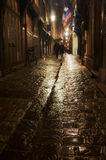 The street and buildings in the rain at night Stock Images